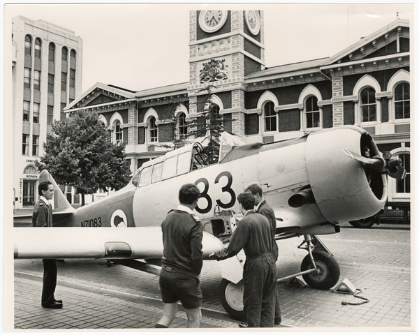 Harvard plane being reassembled in Cathedral Square