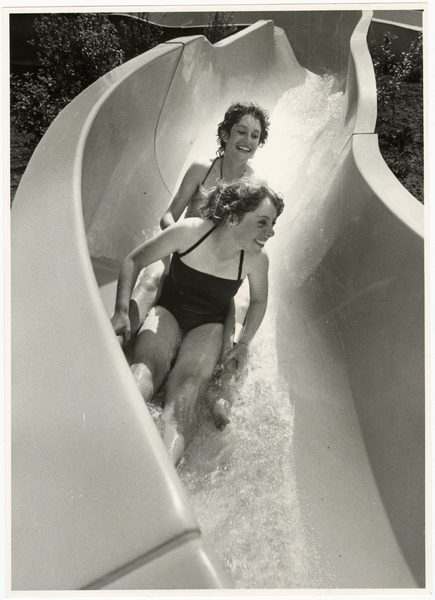 Riding on the water slide at Jellie Park