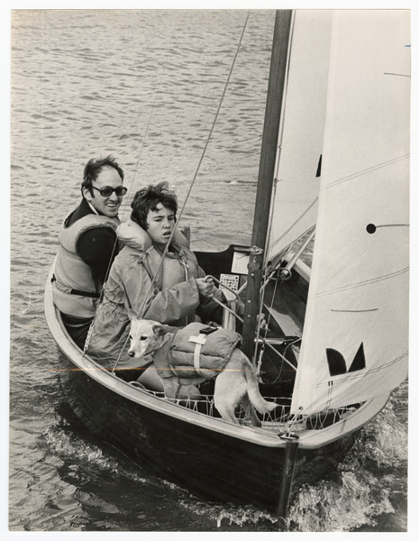Graeme Hore, his daughter and pet dog in a sailboat