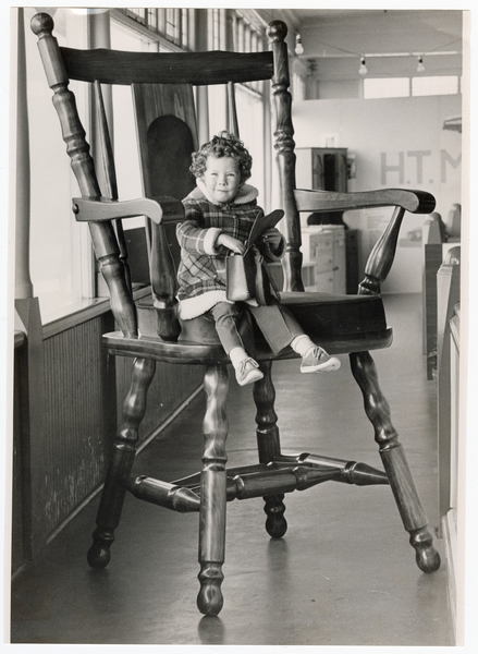 Child on oversized chair, Canterbury Furniture Show
