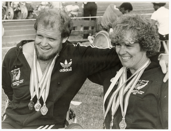 Trish Hill and Graham Condon with Paralympic medals