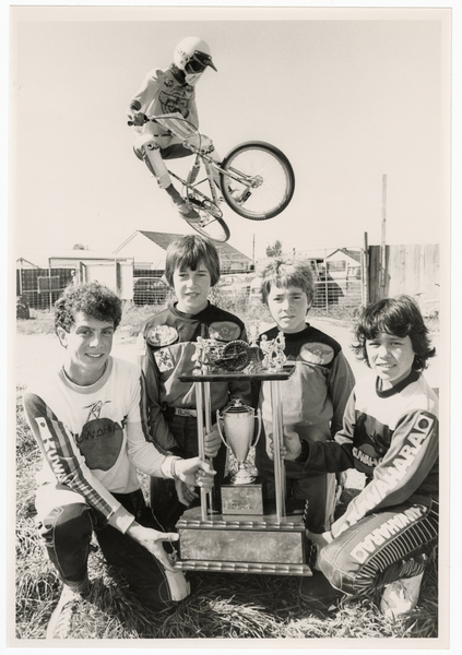 Bishopdale BMX racers with a trophy