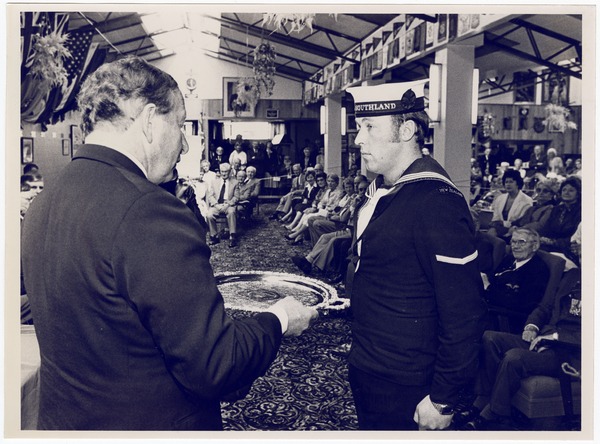 Able Seaman Daniel Douglas being presented with an award