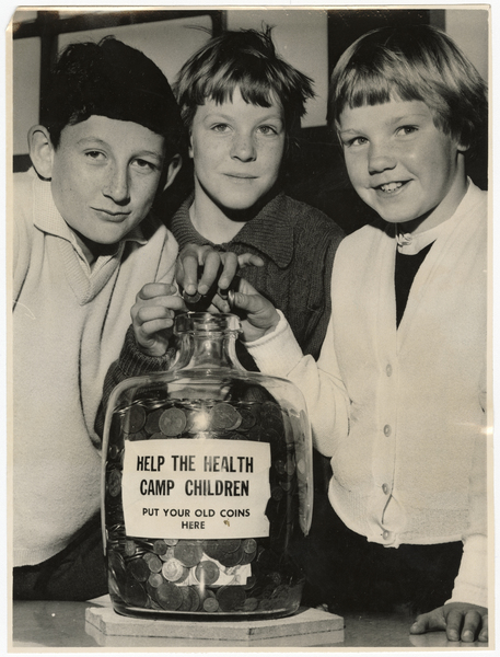 Children with jar of pre-decimal coins