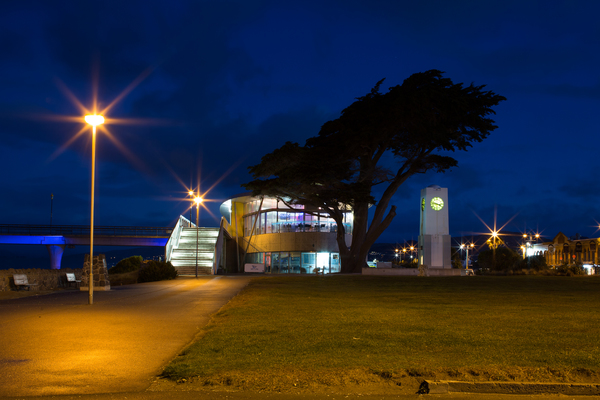 New Brighton Pier, library, and clock tower at night