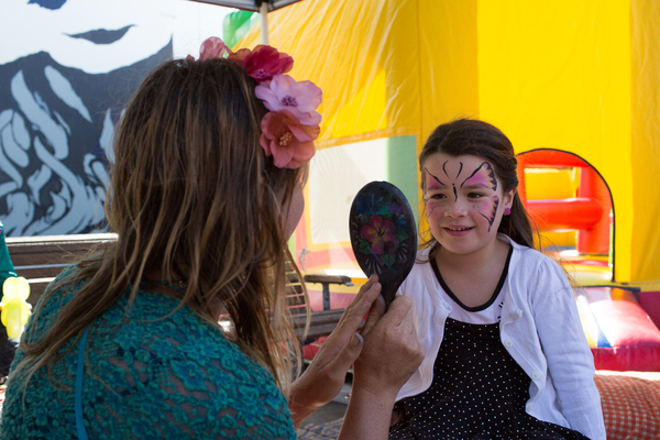 Face painting at the Saturday Seaside Market