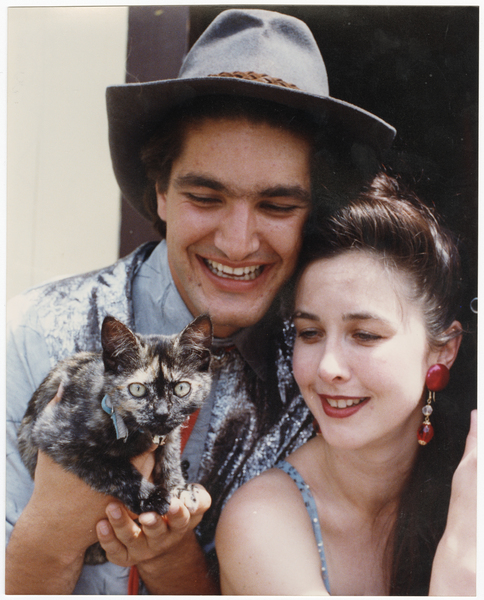 Stelios Yakmis and Theresa Healey with a cat