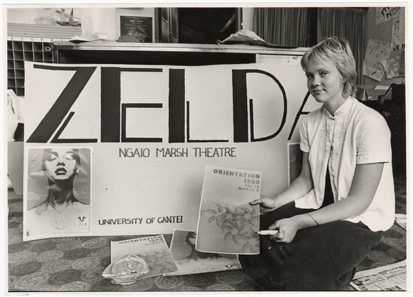 Bronwyn Croxson next to a poster for Zelda