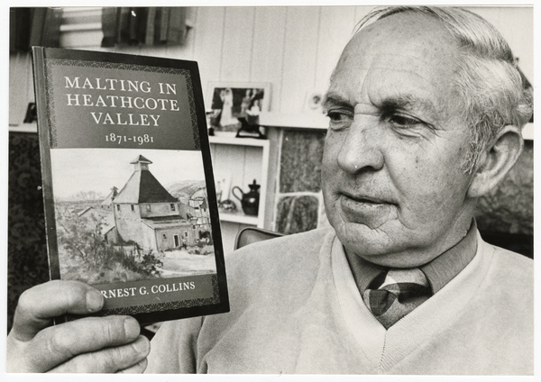 Ernest G. Collins with his book