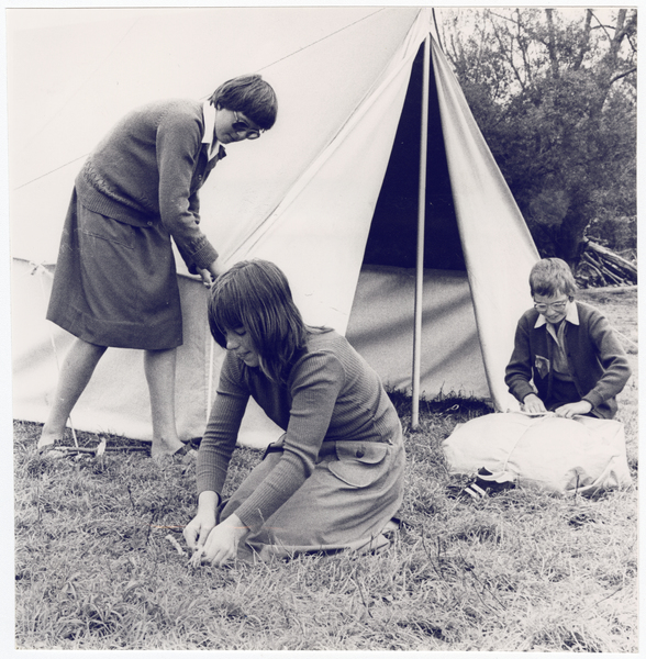 Girl Guides erecting a tent