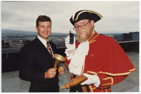 Town Crier, Steve Symonds, with a cell phone