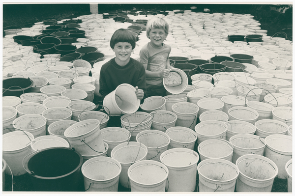 Ben and Thomas Harrow with fruit picking buckets