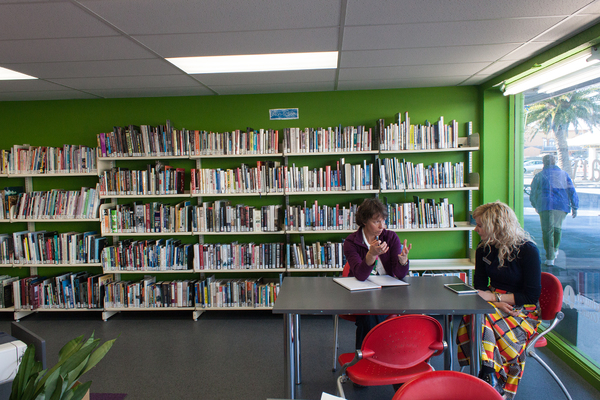 Staff in the temporary new library, New Brighton Mall