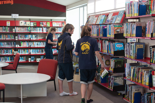 Wave Riders work in the library, South New Brighton School