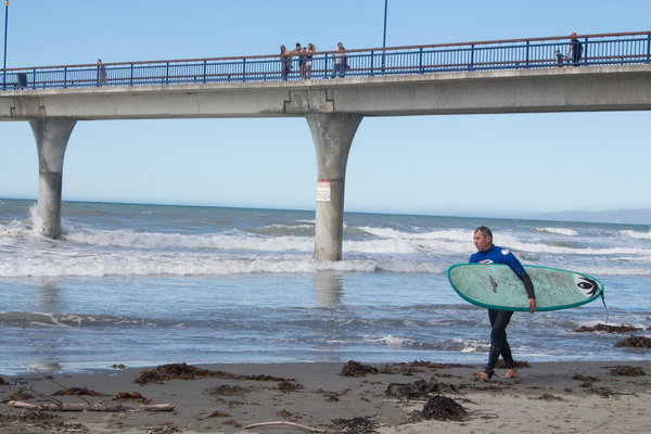 A surfer on New Brighton beach