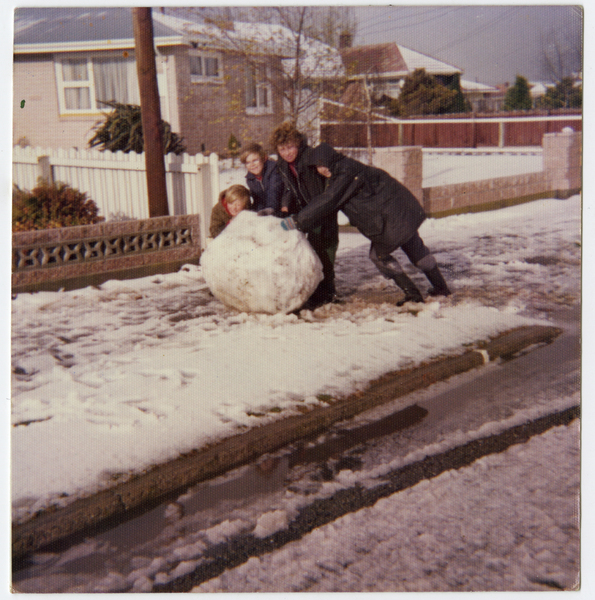 Kids of the neighbourhood and their giant snowball