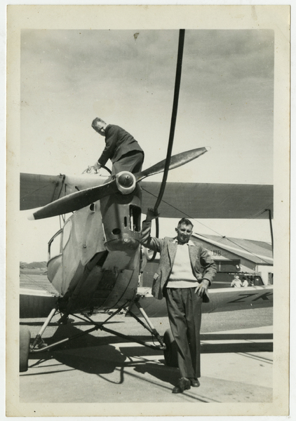 Mr S M Marker of Belfast, refuelling his Fox Moth at Blenheim airfield, 1961