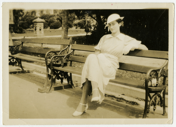 Miss Joyce Macaulay on a park bench