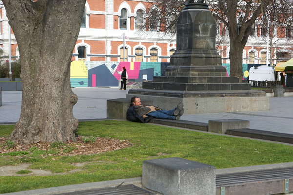 A man sleeping in the square at lunchtime, Cathedral Square