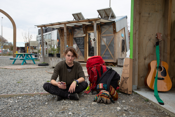 A backpacker, The Commons, a Gap Filler project, corner of Kilmore and Durham Streets