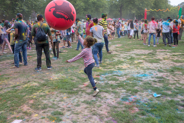Child chasing a balloon at the Holi Festival