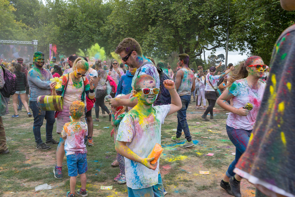 Child throwing colours at the Holi Festival