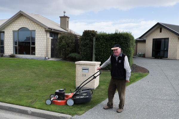 Roger mowing his front lawn in Halswell