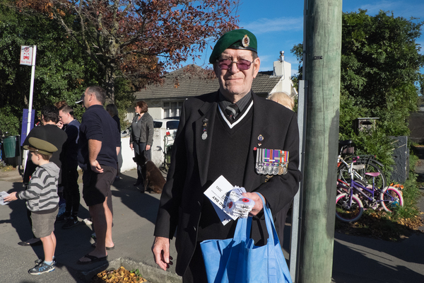 Handing out ribbons at the Anzac Day service in Halswell