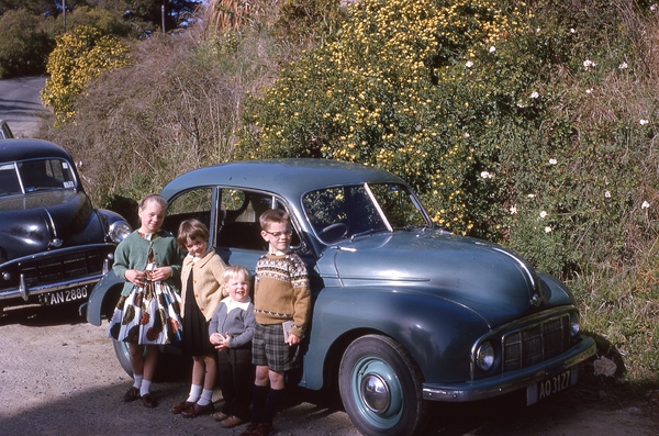 Children by Morris Minor car