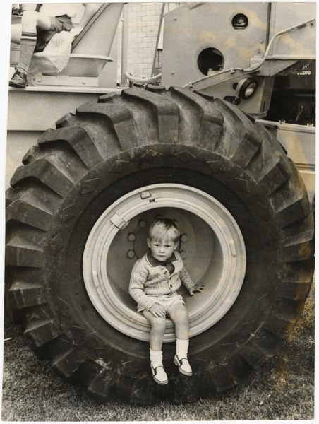 John Gallacher seated in a tyre