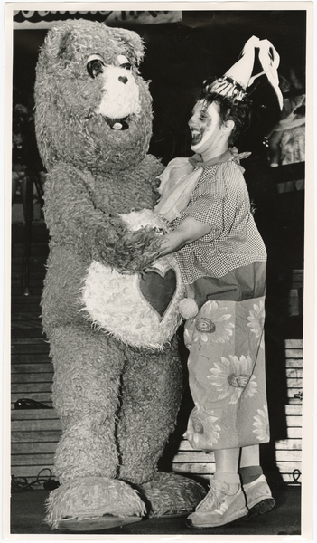 Image of Care Bear and clown dancing at the Starlets Christmas party