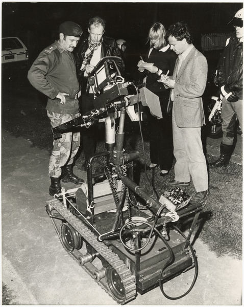 Reporters with bomb disposal robot
