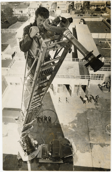 Climbing a fire engine ladder