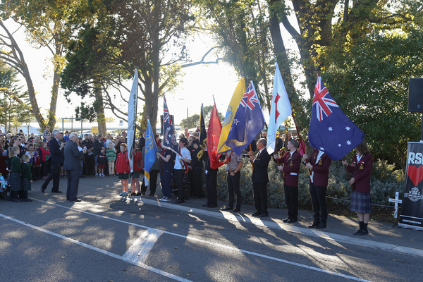 Crowd with flags at Halswell Anzac Day memorial service