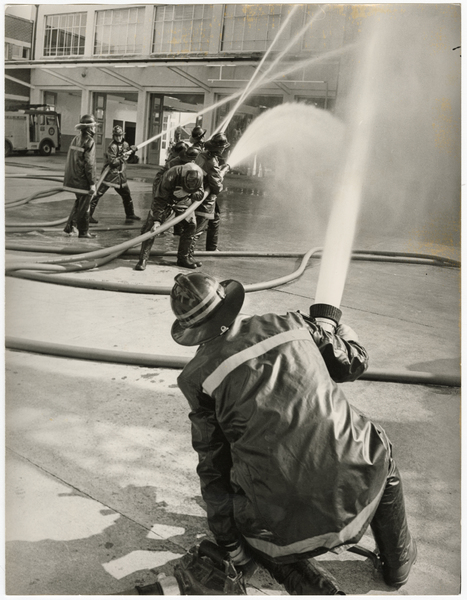Firefighters demonstrating hose use