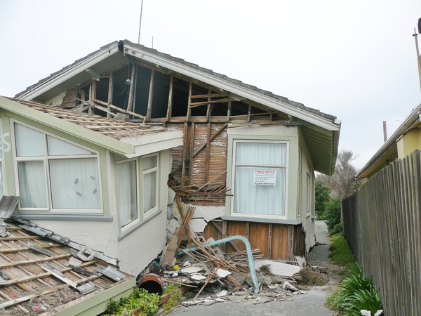 Damaged house with notice