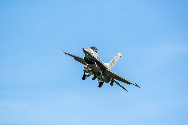 USAF F-16 Fighting Falcon flying overhead on approach to Christchurch