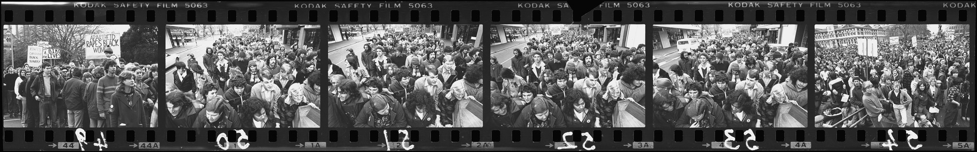 Negative strip from the Christchurch Star Archive showing Springbok Rugby Tour protesters marching to Cathedral Square