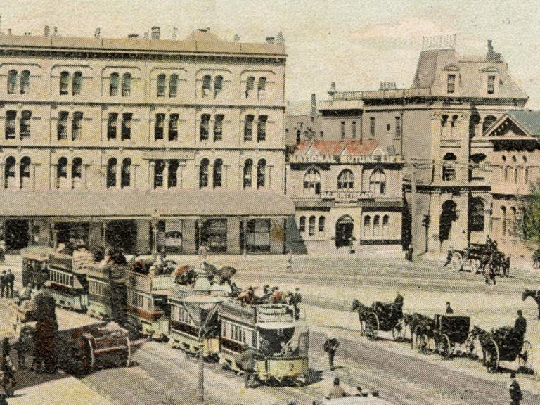 Image of postcard showing trams and horse drawn carriages in the Square