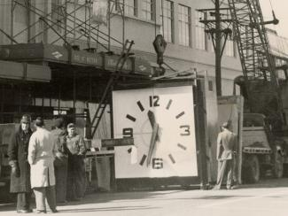 Image of new clock being installed on the MED building