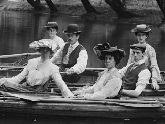 Image of men and women in a boat on the Avon River